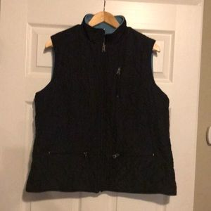 Black quilted vest with blue fleece interior